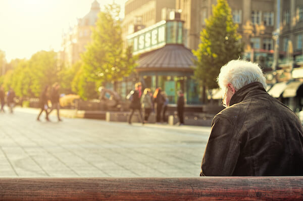 dementia care old guy sitting on bench